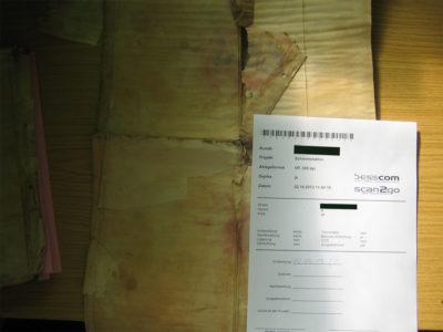 Foto eines schadstoffbelasteten Dokuments mit dazugehörigem Auftragsschein